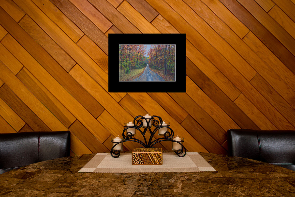 "Home decor scene with fine art matted print of Timothy Stanford's original acrylic painting ""Autumn Road"""